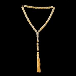 Мусульманские чётки из янтаря на 33 бусины - форма бочонок.