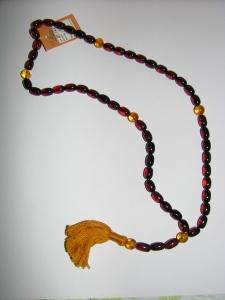 Христианские чётки из цельного калиброванного янтаря на 53 бусины.